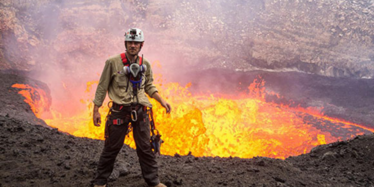 George Kourounis stands in front of lava