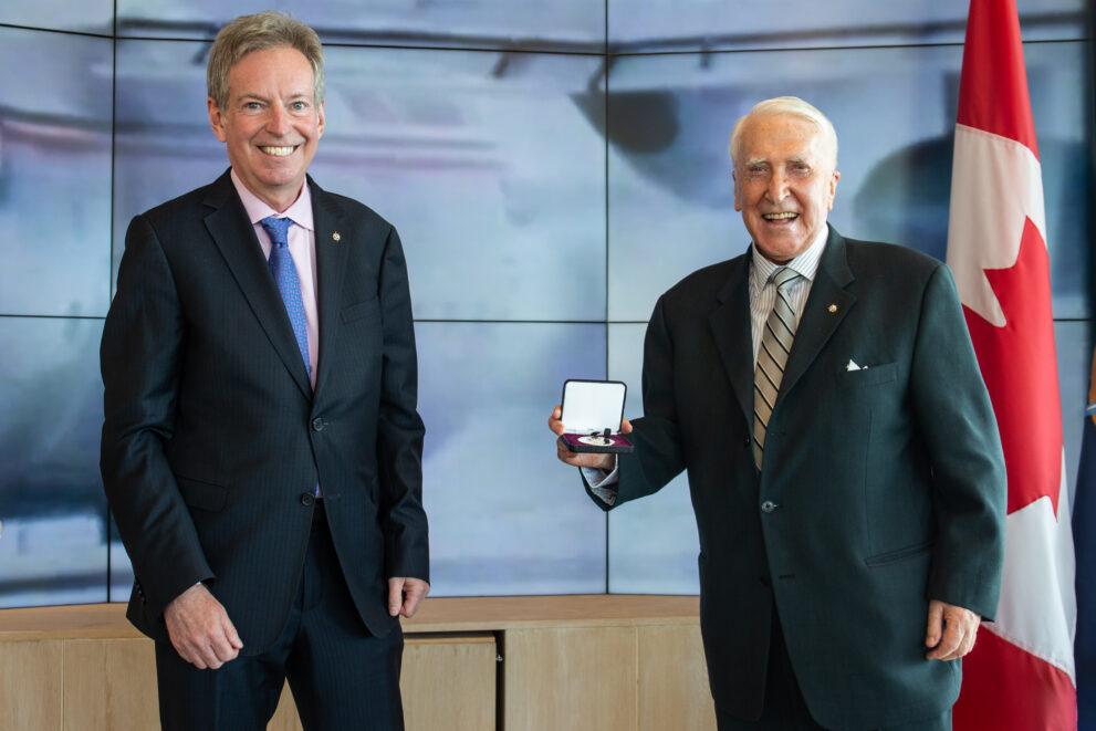 Ken Hedges with medal